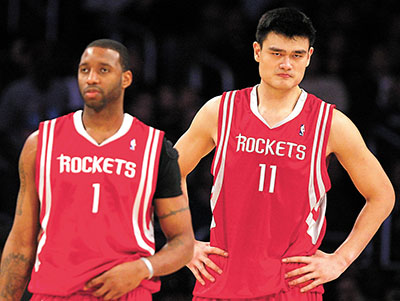 Houston Rockets' Yao of China and McGrady react during NBA basketball game against Los Angeles Lakers in Los Angeles