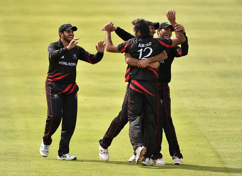 19 July 2015; Tanwir Afzal, centre right, Hong Kong, is rushed by teammates, from left, Kinchit Shah, bowler Haseeb Amjad and Anshuman Rath after catching out Stephen Baard, Namibia. ICC World Twenty20 Qualifier 2015, Hong Kong v Namibia. Clontarf, Dublin. Picture credit: Cody Glenn / ICC / SPORTSFILE