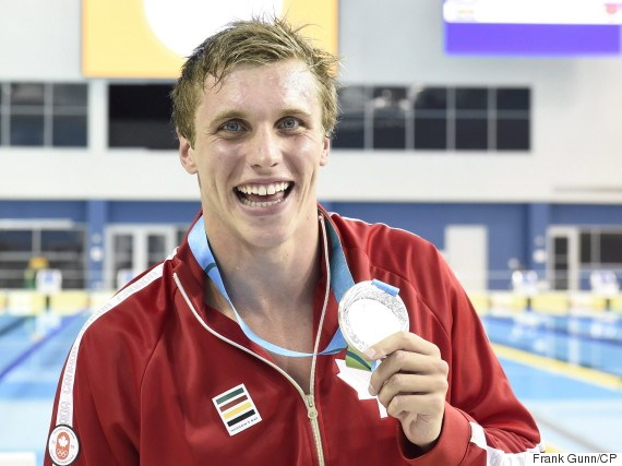 Second place finisher Santo Condorelli, of Canada, poses with his medal after the men's 100m freestyle swimming event at the 2015 Pan Am Games in Toronto on Tuesday, July 14, 2015. THE CANADIAN PRESS/Frank Gunn